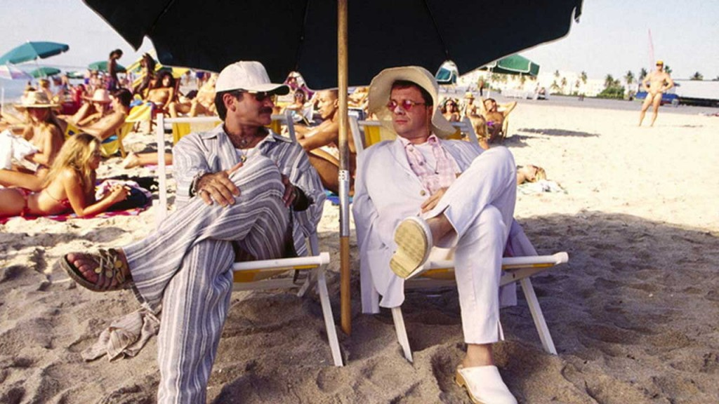 Birdcage co-stars Robin Williams and Nathan Lane as Armand and Albert lounge at the beach