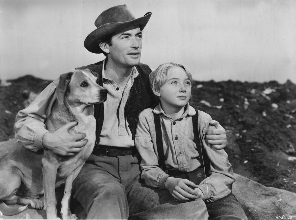 Gregory Peck and Claude Jarman Jr. with dog co-star