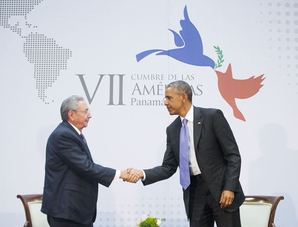 Presidents Barack Obama and Raúl Castro shake hands at the Summit of the Americas