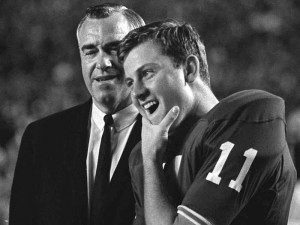 While coaching at UF in the mid-1960s, Ray Graves confers with Heisman Trophy- winning quarterback (and future UF coach) Steve Spurrier.