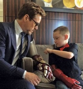 Actor Robert Downey Jr. presents Alex Pring with an Iron Man themed robotic arm
