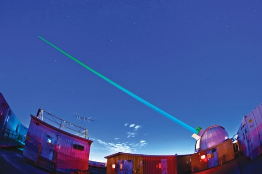 A laser shoots skyward as part of Sandia's Laser Applications project.