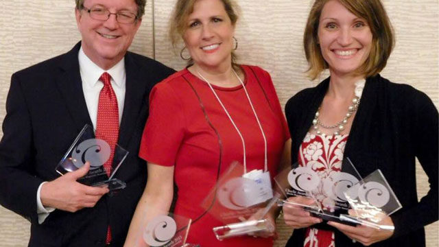 Publisher Susan Revello (center), Associate Publisher Joel Brandenberger (left) and Art Director Melissa Woods at awards dinner