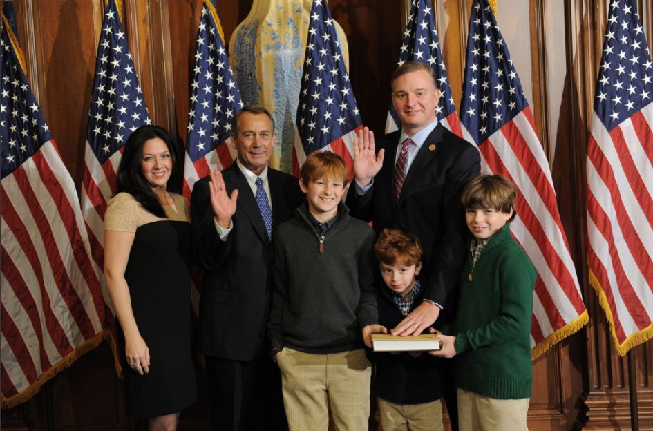 Rep. Tom Rooney and family with John Boehner.