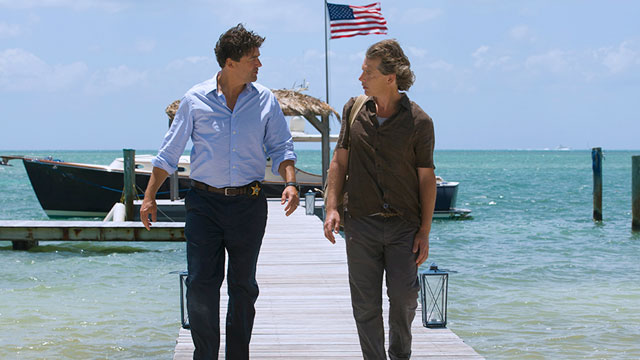 Kyle Chandler and Ben Mendelsohn walk along dock in Netflix series Bloodline