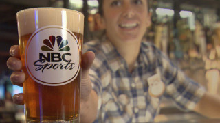 NBC Sports & Grill bartender hands out NBC Sports beer glass