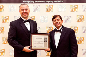 Rob Bernath and jayan Thomas accept the R&D 100 Award