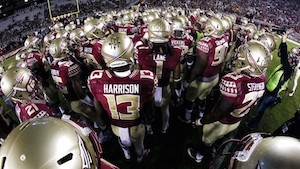FSU football players huddled up