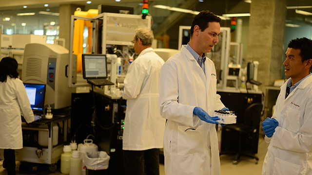 Layton Smith and researchers in lab