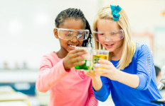 girls perform science experiment