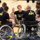 Prince Harry speaking with with wheelchair-bound basketball players