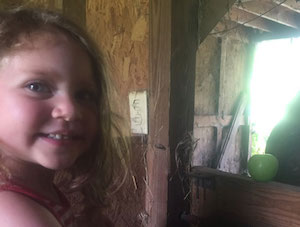 smiling child in barn