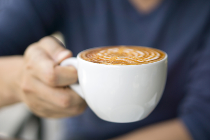 Close-up of male hand holding a cup of coffee
