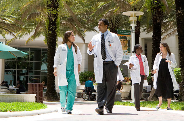 Medical staff walking at University of Miami's Miller School of Medicine campus